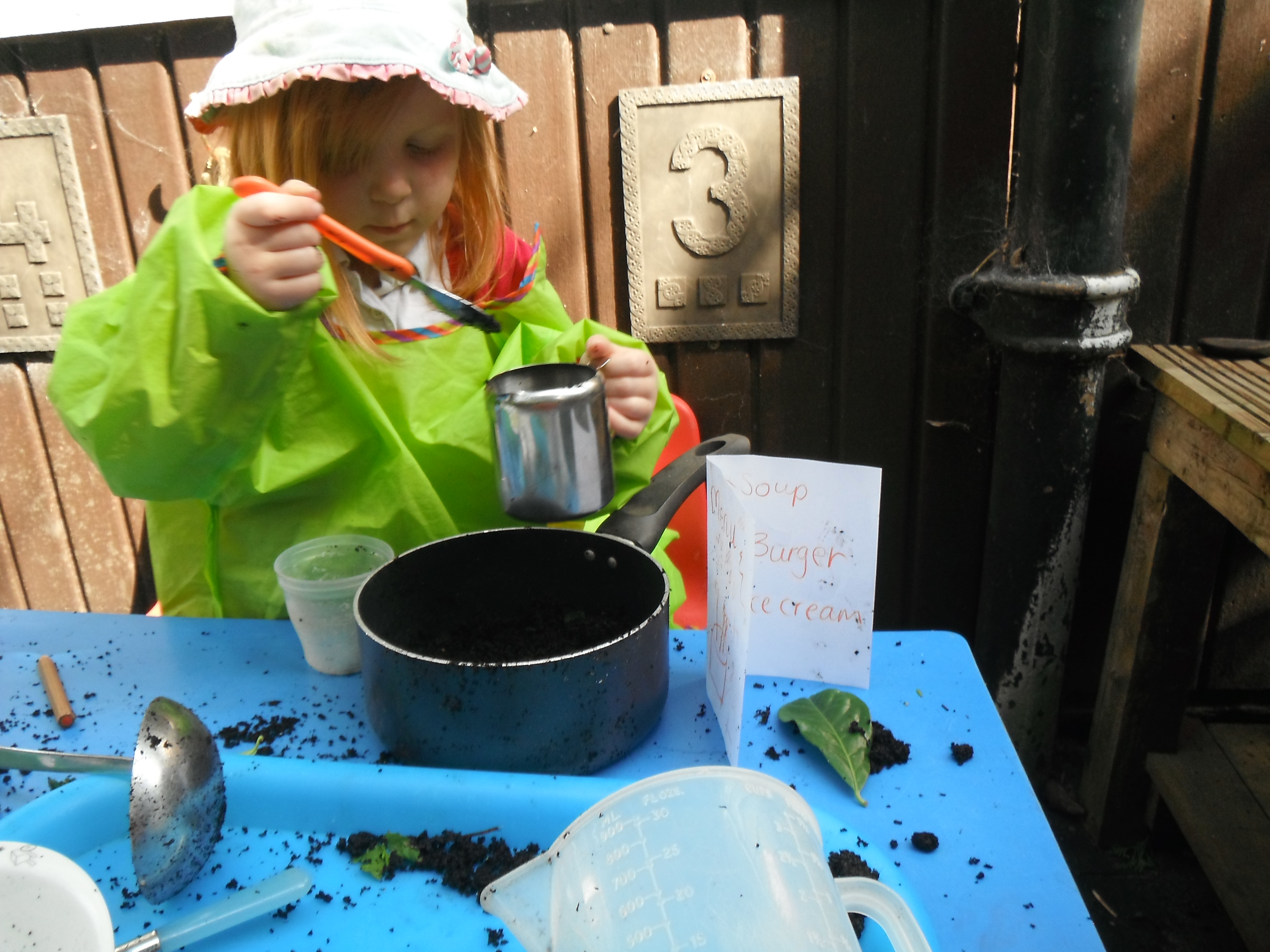 Cooking up a storm in the mud kitchen